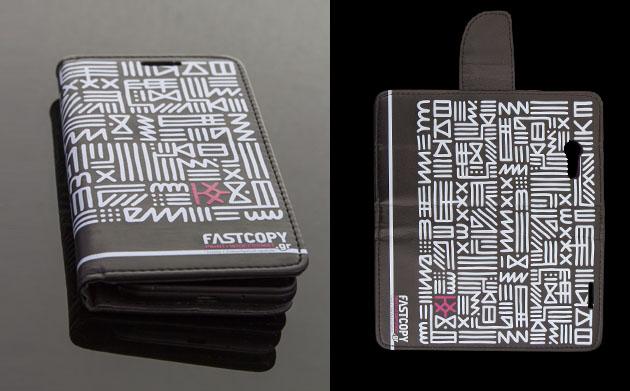θήκη κινητού με εκτύπωση εικόνας με γεωμετρικά σχήματα σε μαύρο φόντο